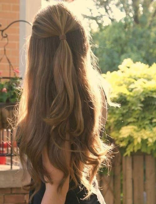 This half-up/half-down hairstyle is absolutely adorable. We're loving it!