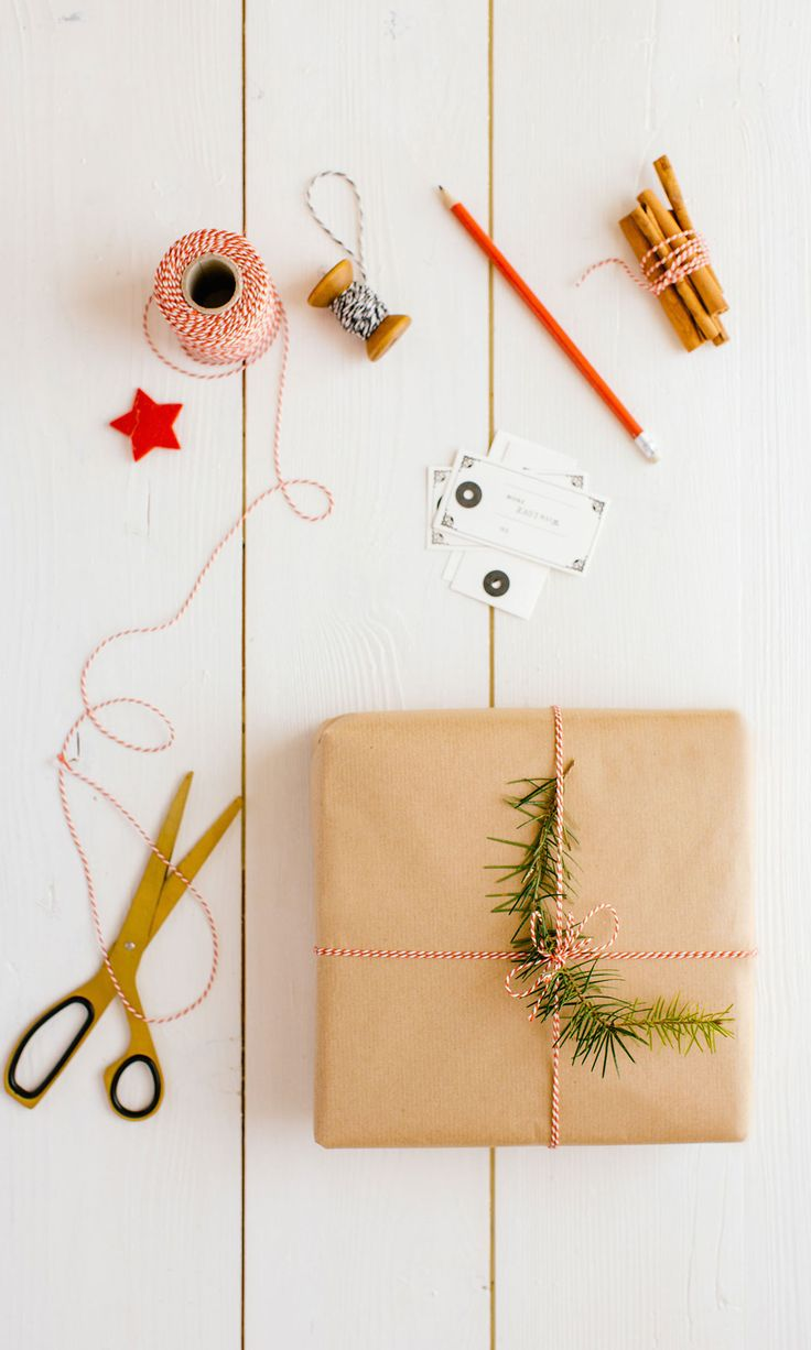 86 best holiday gift guide images on pinterest christmas simple holiday wrapping idea brown paper red bakers twine and a sprig of buycottarizona Image collections
