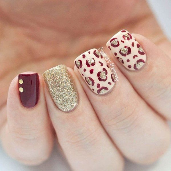 Red, Beige and Gold Glitter Leopard Nail with Golden Beads on Top for Accent.