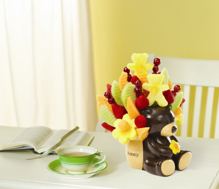 Say Welcome Baby with our ALL NEW Honey Bear Bouquet.™    This adorable fruit bouquet includes fresh strawberries, pineapple daisies, honeydew, cantaloupe and grapes, and is topped off with a cute pineapple teddy bear for a final touch. It's all arranged in our keepsake Honey Bear container that's just right for the nursery once the fruit is gone #products #newbaby #gifts #ideas