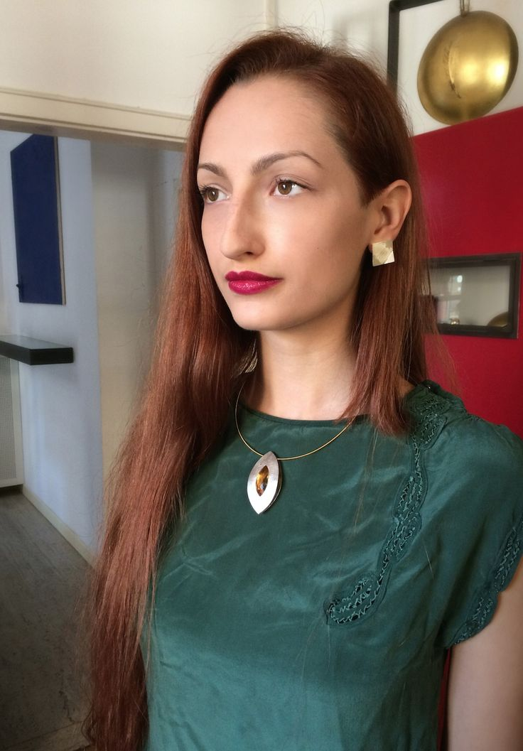Beautiful classy girl wearing custom gold contemporary necklace + silver earrings. © Alberta Vita