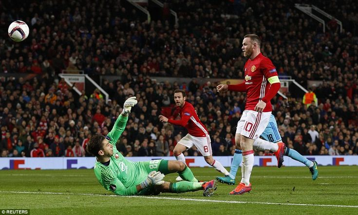 The Red Devils captain watches on as his deft touch flies over former Liverpool stopper Jones and into the back of the net