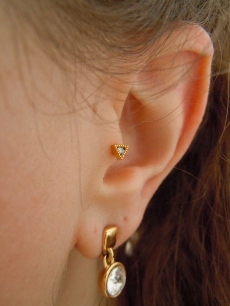 Tiny triangle tragus piercing found from Etsy store Small Talk Jewelry. Earring by Snö of Sweden.