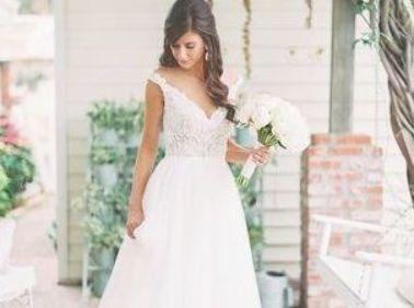 Bride With Loose Curls And V Neck Wedding Dress Wedding Dress