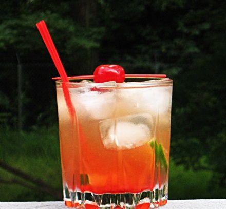 Lion Bite | 2 oz. Southern Comfort, 2 oz. Limeade, 2 oz. Lemon-Lime Soda, .5 oz, Roses Lime Juice, Splash of Grenadine, Lime wheel and/or Cherry to garnish