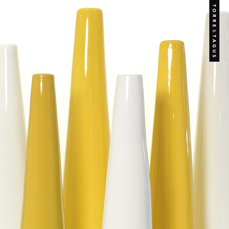 Make a bold and luminous statement in any space with these yellow & white sleek, tapered lacquered Peak Vases. #TorreAndTagus #PeakVases #ColourYourHome #HomeDecor www.torretagus.com