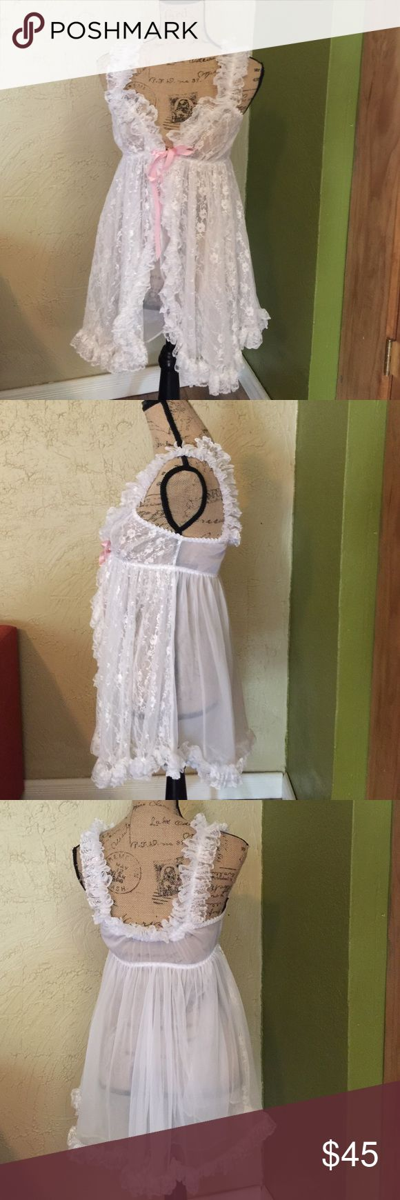 Vintage lace lingerie top Babydoll tank style top , sheer white lace with pink bow. Has a sheer liner built in underneath , gorgeous vintage piece in excellent condition Vintage Intimates & Sleepwear Chemises & Slips