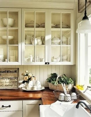 Wood countertops with white cabinets -- nice combination.