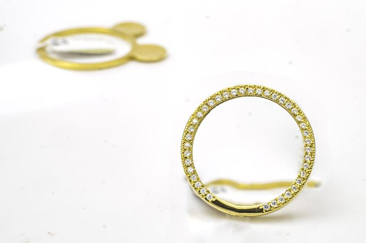 A pair of golden rings, designed to be worn together as one piece, are photographed against a white background as part of an ongoing job I have.