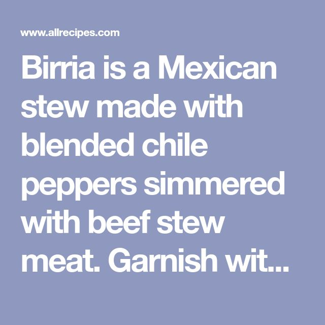 Birria is a Mexican stew made with blended chile peppers simmered with beef stew meat. Garnish with cilantro, lime, and onion.