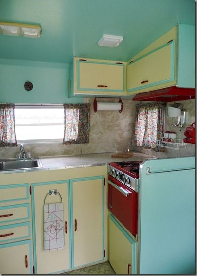 Vintage shasta camper kitchen. i like the way the upper cabinet doors are hinged. Wonder if it is hard to get them to stay open? Hydraulics? Braces?