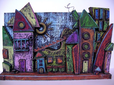 Architecture sculpture: made from wood scraps glued together, then base coated black, then coloured with oil pastels. Looks like cool blackboard effect!