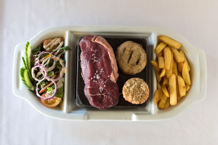 Our delicious Black Rock Grill - theatre in the dining room! Cook your own steak to perfection and watch it sizzle