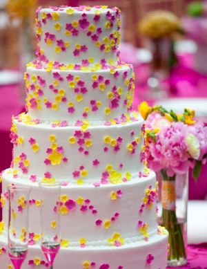 White cake with pink and yellow flowers