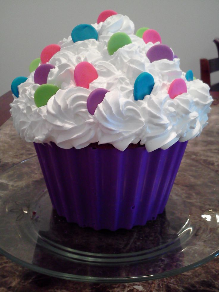 Giant Cupcake Cake - Strawberry cake with whip cream icing and fondant decorations.