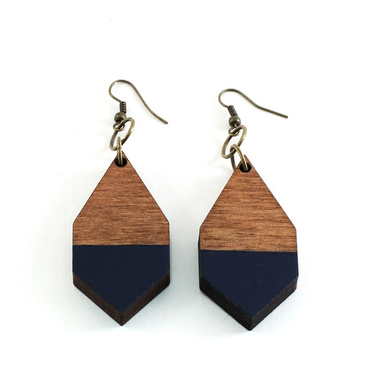 The DIAMANTE earrings are made of lightweight Finnish birch plywood.  They add a splash of color to any outfit! Handpainted and handmade in Helsinki, Kruununhaka.