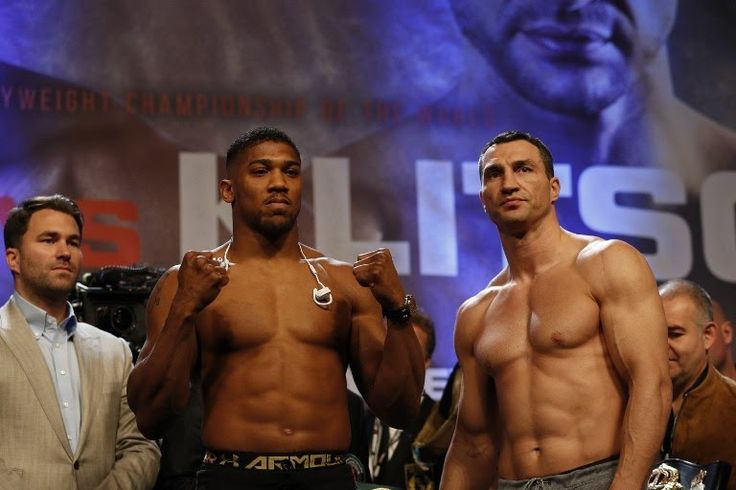 British boxer Anthony Joshua (L) and Ukrainian boxer Wladimir Klitschko (R) pose with each other during the weigh-in ahead of their world heavyweight title unification bout at Wembley in London on April 28 2017.AFP PHOTO / Adrian DENNIS  ANTHONY JOSHUA has been told there are two bids on the table from Nigeria to stage his world heavyweight title rematch against Wladimir Klitschko according to The Sun.  His promoter Eddie Hearn has been sifting through mega-money offers to put the fight on…