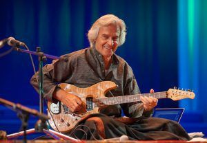 When it comes to virtuosi, guitarist John McLaughlin ranks high in the jazz fusion world. Having the early fortune to connect with legendary drummer Tony Williams upon arriving in New York from his…