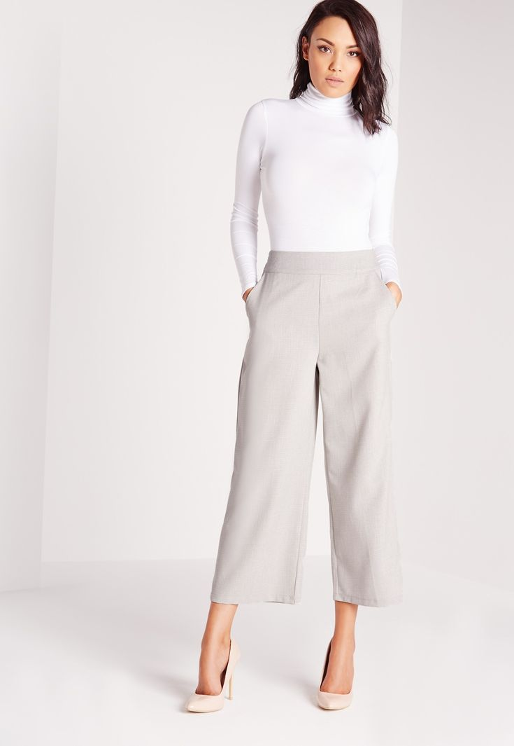 For the ultimate in smart work wear vibes, you need these wide legged trousers in chic grey. These chill pants come in a flattering cropped leg and wide style, with lightweight material for easy wear. Pair with the matching long line jacket...