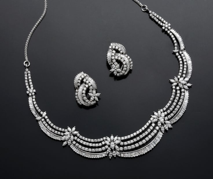The Designer Wear Diamond Necklace Studded With Marquise, Tappers & Baguettes And Round Diamonds.