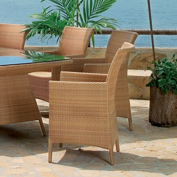 brown wicker weaving chair with armrest of wicker chairs for warmth in dining table