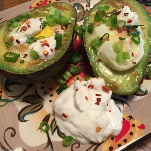Avocado recipes. Baked stuffed avocado egg makes a yummy breakfast, lunch or dinner meal.