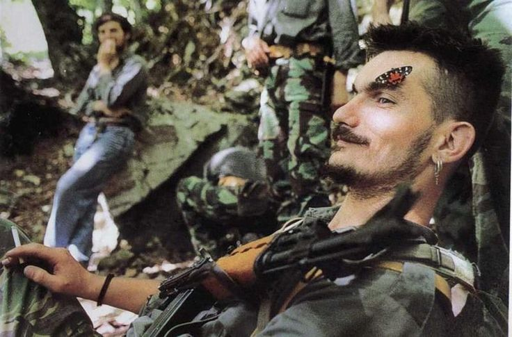 A butterfly lands on the face of a resting Bosnian Serb soldier, near the Eastern Hercegovian town of Konjic.