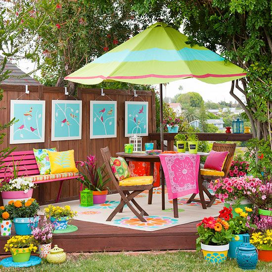 Playful patterns and bright colors give this outdoor space youthful energy. More fabric makeovers for outdoor rooms: http://www.bhg.com/home-improvement/porch/outdoor-rooms/outdoor-fabrics-and-rooms/?socsrc=bhgpin082313greenumbrella=16