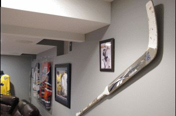 floating a goalie stick on the wall
