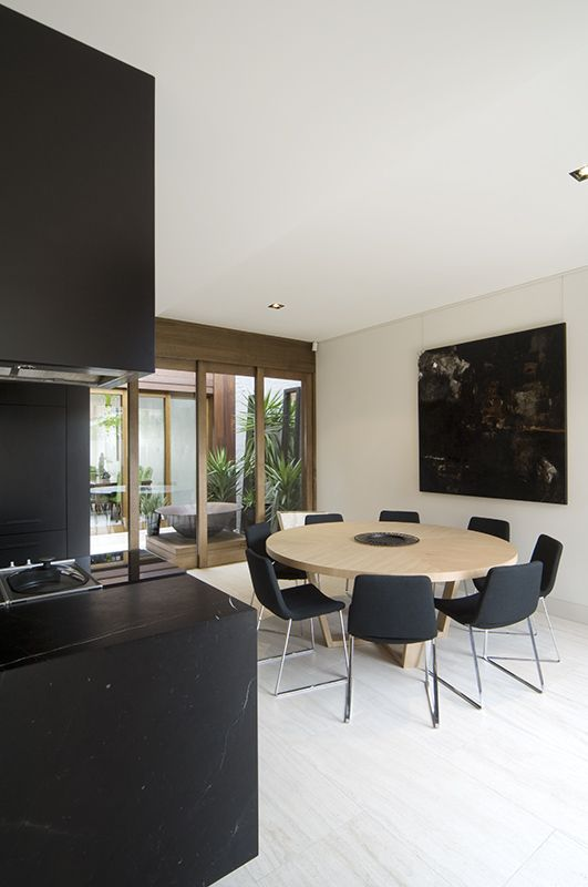 Our Waltz chairs looking great around this natural oak table Black and bold Melbourne home design | Designhunter - architecture design blog