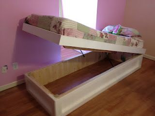 My husband is a GENIUS. He built TWO of these for our oldest two girls to fit inside the dormers in the girls' room! Check them out... just awesome!