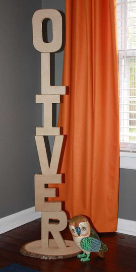 these are the cardboard paintable letters you can get at michael's or joann's - instead of painting them and putting them on the wall like everyone else, stack them and make a cool vertical word. i love it!  Fun for a party, kids room, school classroom or playroom.