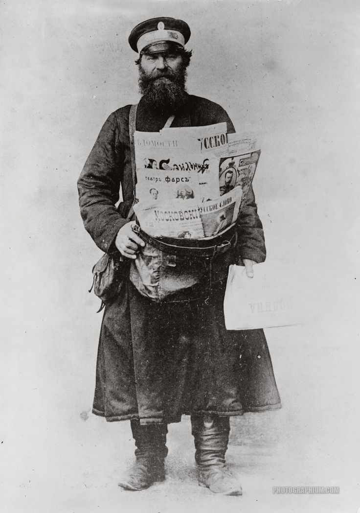 Russian newsboy. Russian newspaper delivery man posed, standing, full-length, with bundle of newspapers. Russia. 1900-1918.  Photo Courtesy Library of Congress Archives Nashville Tennessee Collection