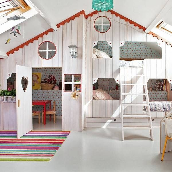 Eclectic Kids Bedroom with Concrete floors, Skylight, Wall sconce, Built-in bookshelf, Exposed beam, Bunk beds, High ceiling