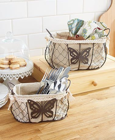 Add extra storage with a rustic look to your home with Fabric-Lined Storage Baskets. Each wire basket has a removable polyester liner. Set of 2 Butterfly Baskets features beautiful butterfly accents and looks great on a countertop or table.