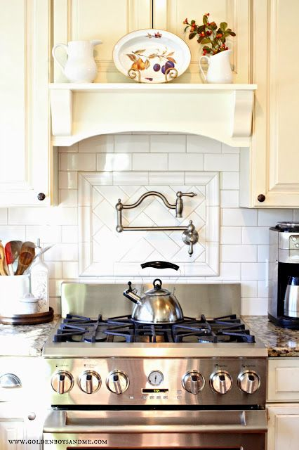 belle foret pot stainless steel pot filler with white subway tile backsplash and diy mantel range hood-www.goldenboysandme.com