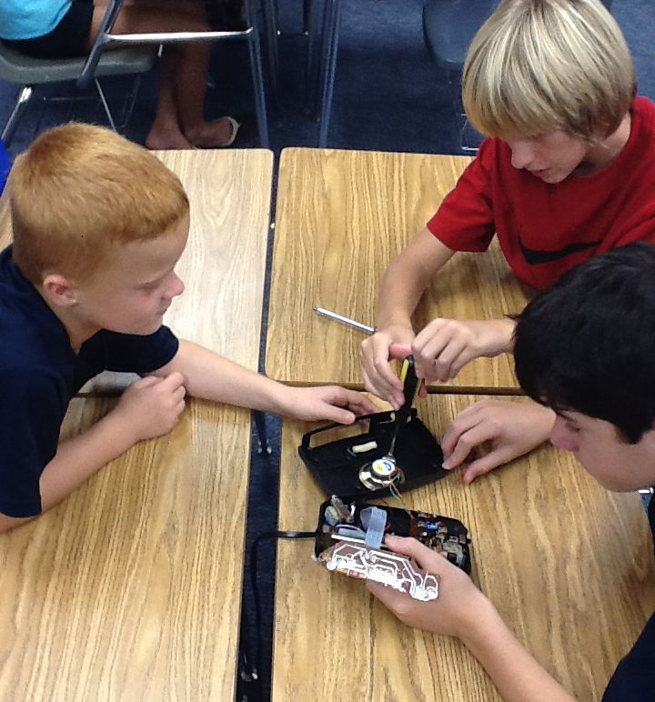 A group of summer campers work on a technology project