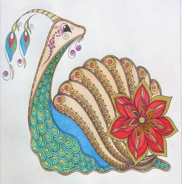 """A kép címe: Ne higgy, a látszatnak!  CsiPa, a félénk kis csiga  """"Csi"""", mint csiga, """"Pa"""", mint páva.   CsiPa látszatra közönséges kis csiga, de csak látszatra, mert ő nem hétköznapi, hanem nagyon különleges... olyan, mint te!  Pattern for coloring book. Coloring book pages for kids and adults. Illustration of a snail. Henna Mehndi Tattoo Style Doodles"""