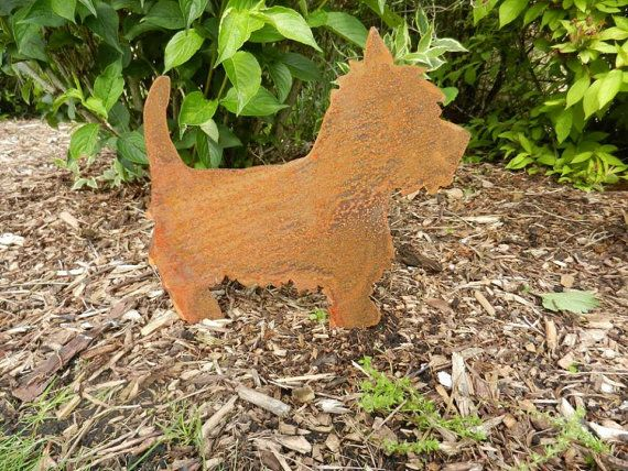 Rusty Metal West Highland Terrier...Perhaps an ideal dog memorial. This gorgeous Westie looks fantastic in any garden setting. Complete with two tabs, this sturdy little fellow can easily be displayed / pushed into the ground. The rusty patina gives a natural and unique finish, which continues to mature and look better with age. Best of all the Westie requires no maintenance and does not need protection from bad weather. This is one piece of garden décor that will maintain its beauty...