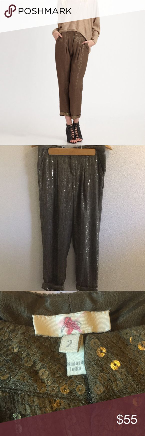 Sequined Joie Trousers Sequined olive green trouser pants by Joie. Zips up at the front with hook closure. Pockets on the sides. No flaws, freshly dry cleaned. 100% silk. I ship daily - excluding Sundays and holidays - and I store items in a smoke free, pet free environment. Open to offers; bundles discounted! Joie Pants Trousers