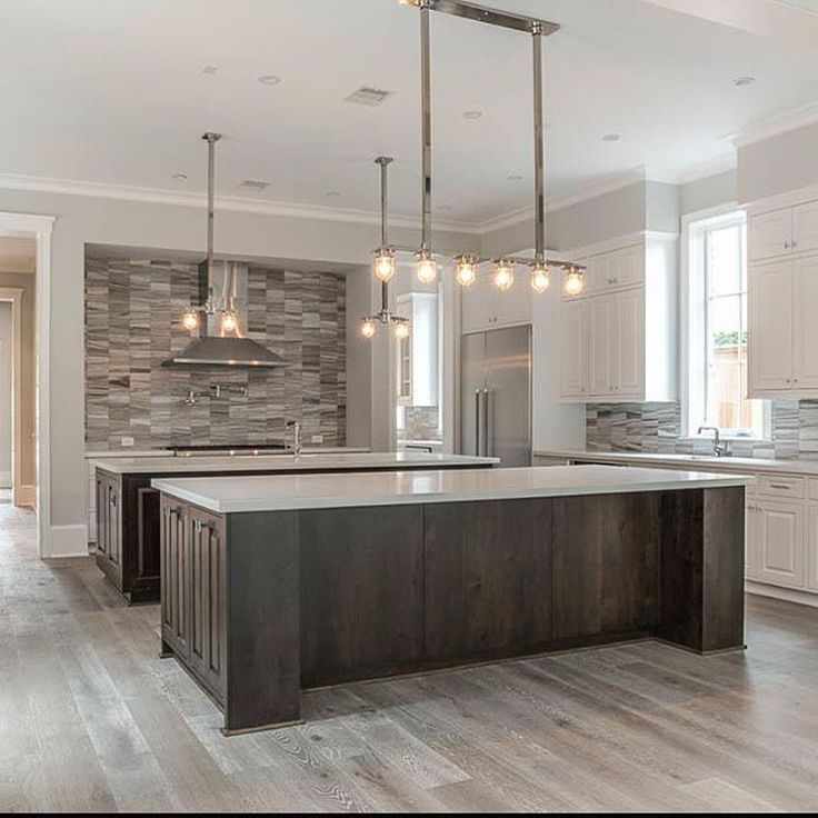 "We Love This Double Island Kitchen Huge Open Kitchen: ""We Love This Double Island Kitchen!"" Huge Open Kitchen Floor Plan! Dark Cabinets. Marble. White"