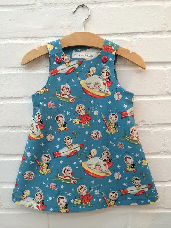 Pinafore dress in 'Retro Rocket Rascals' fabric by by TillyandLola