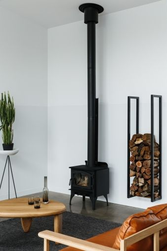 A simple combustion heater warms the extension and filters back into the existing house