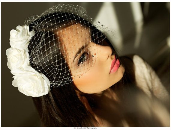 This birdcage veil is handmade with Russian netting. Clear crystals attached along the bottom veil edge. Attached to two bobby pins.  Veil size