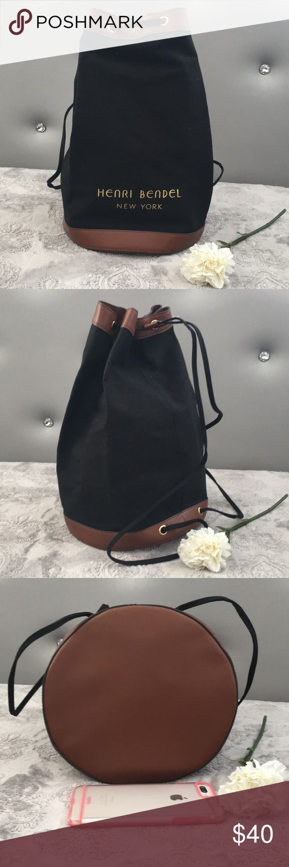 NWOT Henri Bendel canvas/leather promotional bag Promotional drawstring canvas backpack with vinyl lining and leather trim by Henri Bendel. Never used. Comes from a smoke free home. henri bendel Bags Backpacks