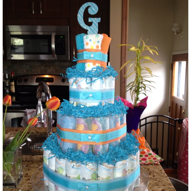 Diaper cake with regular and little swimmers, some wash clothes to top it off!