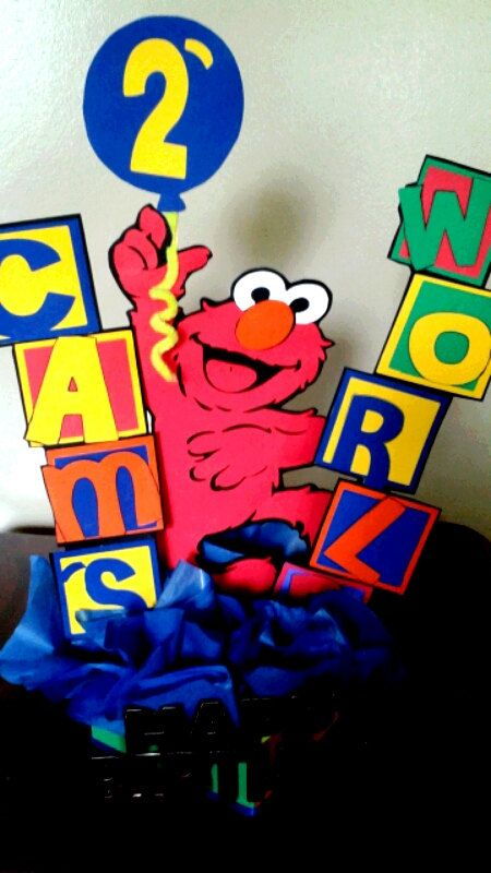 This is a very cute Elmo centerpiece. Its perfect for your Sesame Street birthday or babyshower theme party. Centerpiece is 17 inches high. I can add name, age and happy birthday to centerpiece. Made with love and care. Please allow 1-2 weeks for delivery. Please visit my shop for many