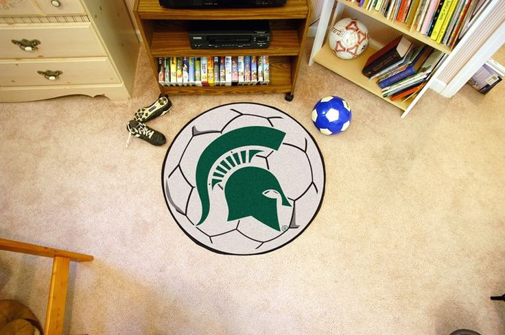 Customize any room in your home or office and show your team pride with this Michigan State University Soccer Ball by Fanmats. The nylon mat is chromojet painted in the team colors and decorated with