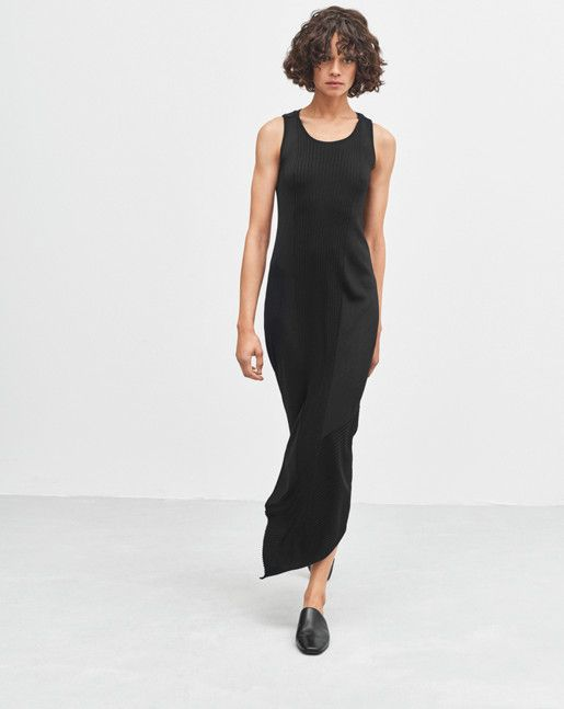 Tank dress made in a lustrous knit. Straight fit and an asymmetrical rib-knit detail at the hem. To maintain the fit, we recommend that you store the dress folded rather than hanging. <br><br> • Straight/regular body<br> • Mid calf length<br> • Slit at