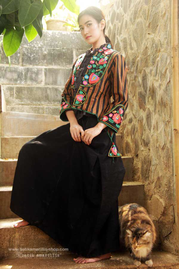 Proudly presents Batik Amarillis's Arcana embroidery jacket #3  in gorgeous Lurik Surjan  of Jogjakarta-Indonesia  ....Stand out in the crowd with this unique and stunning jacket!this contemporary & yet vintage style is accented with exquisite full Hungarian embroidery also features 4 triangle arcana tassels to complete the whole extravangant work of art!.